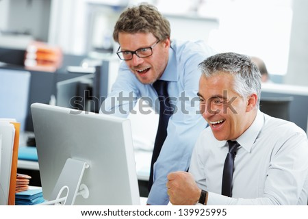 Business success team in an office in front of a screen computer