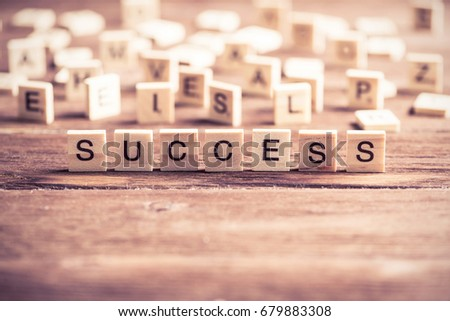 Business success word collected of elements of wooden elements with the letters #679883308