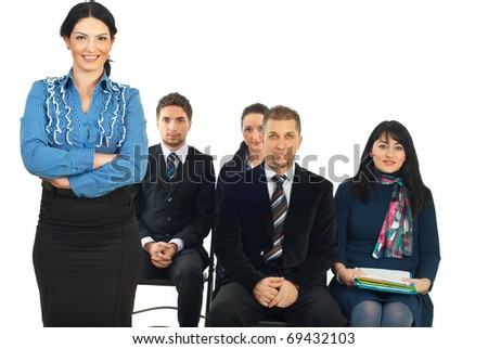 Business teacher woman standing in front of classroom with hands crossed isolated on white background