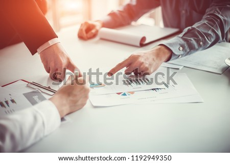 Business team analyzing income charts and graphs in office.  Close up.Business analysis and strategy concept. Foto stock ©