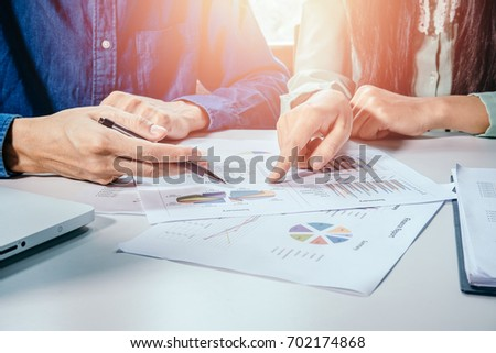 Business team analyzing income charts and graphs with modern laptop computer. Close up.Business analysis and strategy concept. #702174868