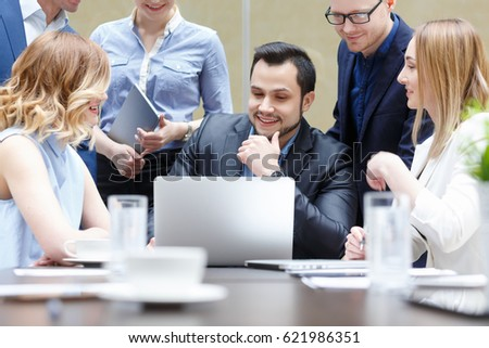 Business team and coworkers are discussing about global economy with laptop and graph screen. Startup business teamwork brainstorming meeting concept. People working planning start up. - Shutterstock ID 621986351