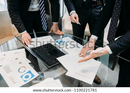 business team argument debate. statistics papers lively discussion. executives or managers review report documents with graphs and diagrams #1100221781