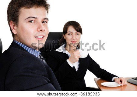 Business team at a coffee break looking at camera