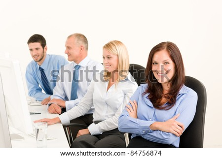 Business team attractive woman sit in line behind computer table #84756874
