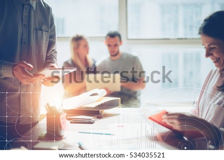 Business team brainstorming. Marketing plan researching. Paperwork on the table, laptop and mobile phone. Statistic graph overlay, icon innovation interface #534035521