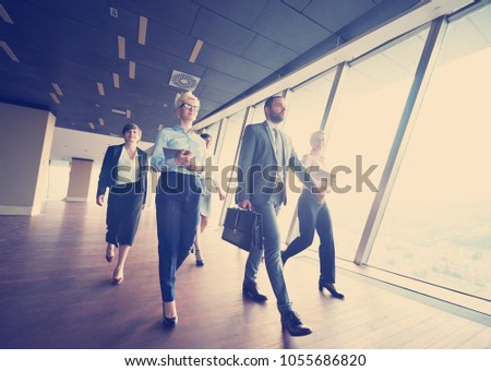 business team, businesspeople  group walking at modern bright office interior #1055686820
