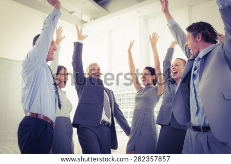 Business team celebrating a good job in the office