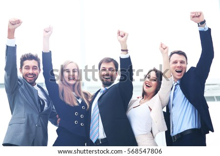 Business team celebrating a triumph with arms up #568547806