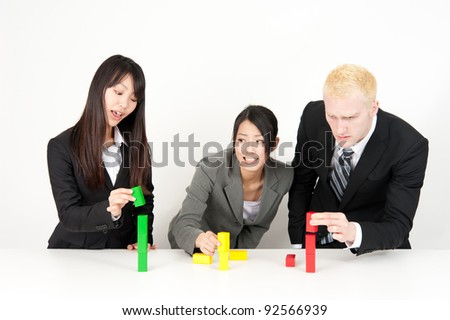 business team competing to make building