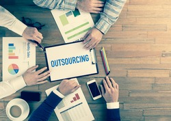 Business Team Concept: OUTSOURCING
