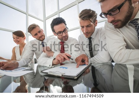business team discussing financial documents #1167494509