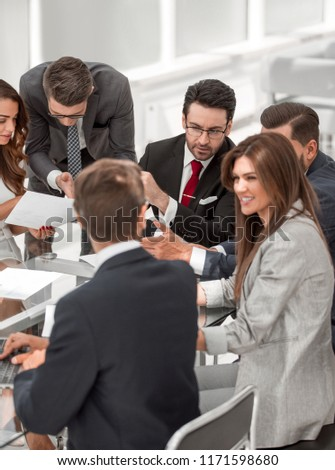 business team discussing financial performance #1171598680