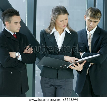 Business team discussing over modern background - stock photo