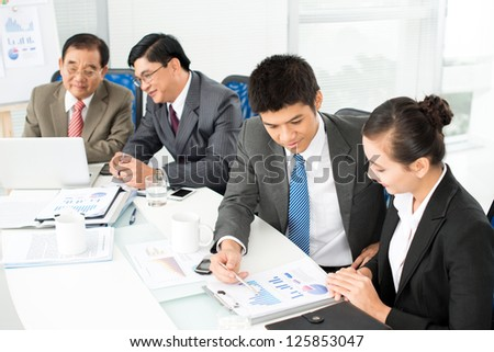 Business team discussing working problems