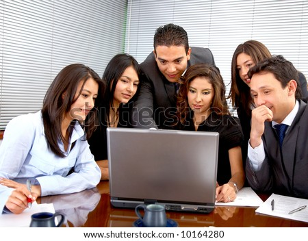 business team during a meeting in an office looking at a laptop computer