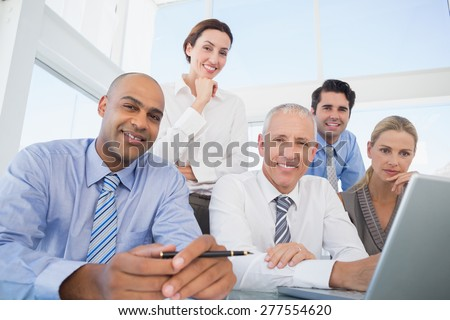 Business team during meeting smiling at camera in the office #277554620