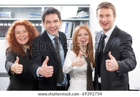 Business team express positivity in office