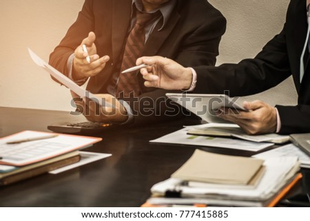 Business team financial inspector and secretary making report, calculating or checking balance, Audit concept at working with plan and analyzing investment charts at his workplace.