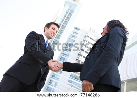 Business team handshake between man and woman of different ethnicities