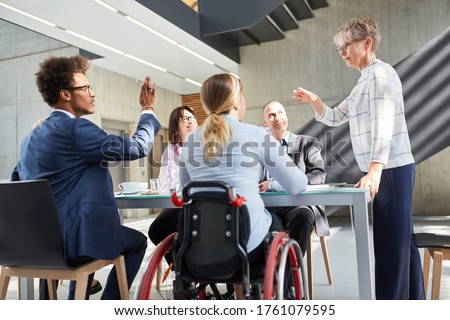 Business team having a discussion in a meeting for inclusion and diversity