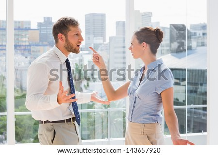 Business team having a heated argument in a bright office