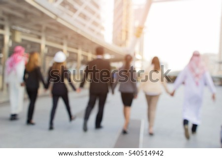 Business team hold hand together to leader of business(blur for background) #540514942