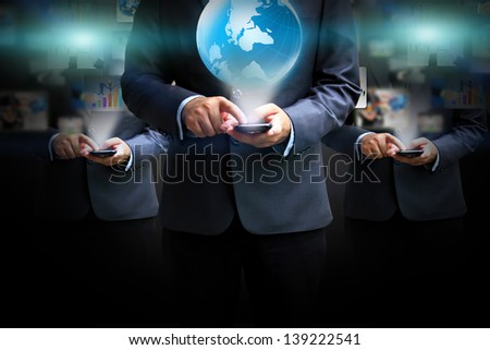 Business team holding business world
