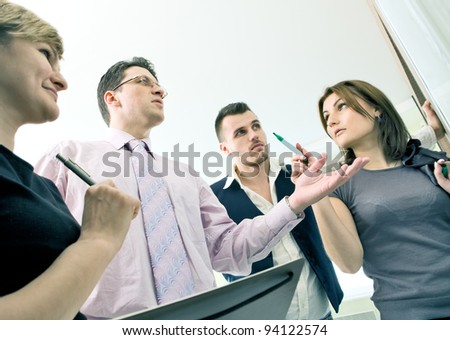 Business team in discussion working together in board room
