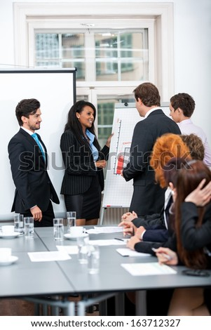business team in office meeting presentation conference people teamwork