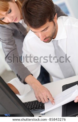 Business team in office working on desktop computer