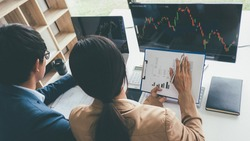 Business team investment trading do this deal on a stock exchange developing new approaches.