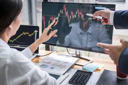 Business team investment working with computer, planning and analyzing graph stock market trading with stock chart data, business financial investment and technology concept.