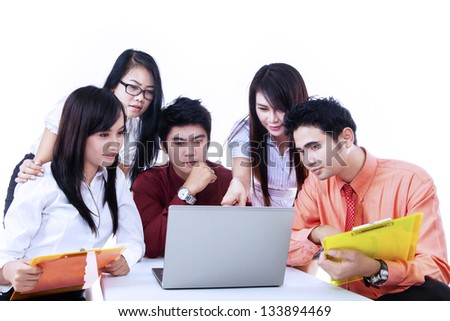 Business team is having a discussion using laptop on white background