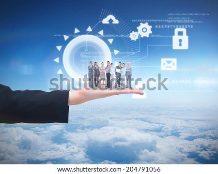 Business team looking at camera against blue sky over clouds at high altitude