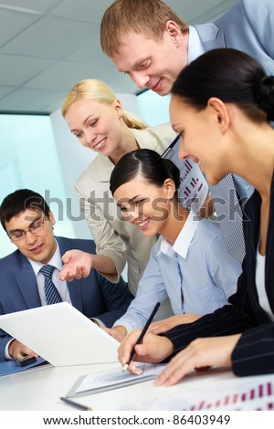 Business team looking at laptop screen