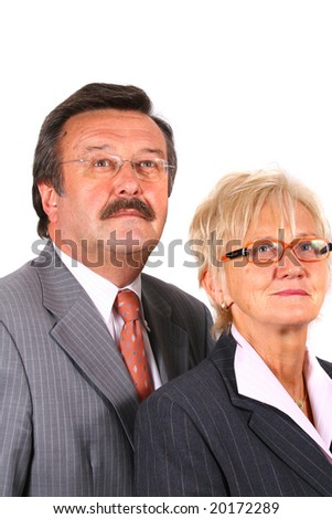 Business Team Looking Into The Future A senior business couple in suits in their 50s and 60s. Isolated over white.