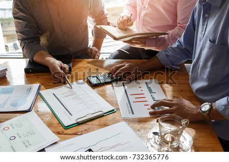 Business team meeting and discussing project plan. Businessmen discussing together in meeting room. Professional investor working with business project together. Finance managers task.