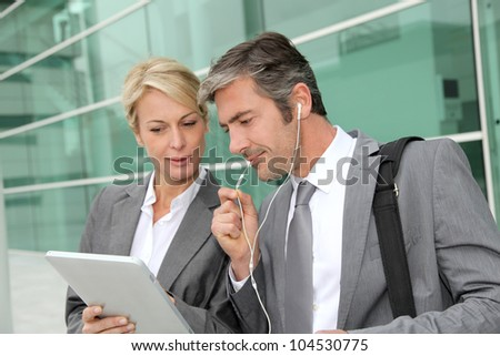 Business team meeting outside with tablet