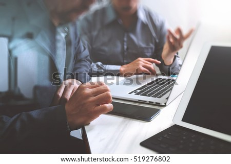 Business team meeting. Photo professional investor working new start up project. Finance task.Digital tablet docking keyboard laptop computer smart phone using, filter film effect