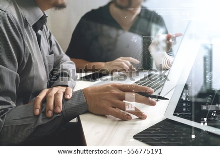 Business team meeting. Photo professional investor working new start up project. Finance task.Digital tablet docking keyboard laptop computer smart phone using, filter film effect #556775191