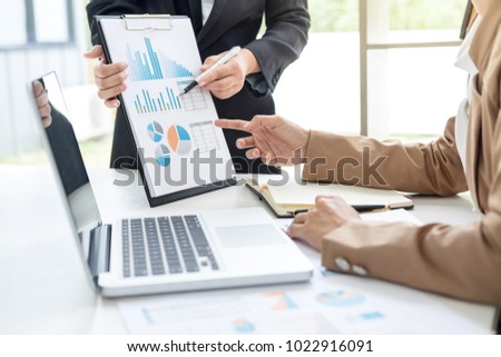 Business team meeting present, investor executive colleagues discussing new plan financial graph data on office table with laptop and tablet, Finance, accounting, investment. #1022916091