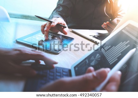 Business team meeting present. Photo professional investor working new startup project. Finance meeting.Digital tablet laptop computer  smart phone using, keyboard docking screen foreground,filter