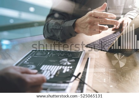 Business team meeting present. professional investor working new start up project. Finance managers meeting.Digital tablet keyboard docking screen computer design smart phone using, sun effect