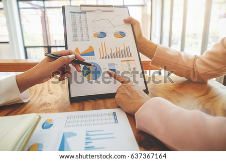 Business team meeting present. Professional investor working with new startup project. Digital tablet laptop computer design smart phone in office.