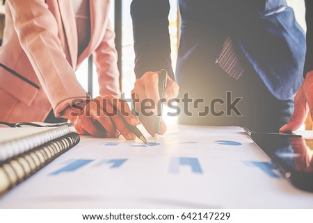 Business team meeting present. Professional investor working with new startup project. Digital tablet laptop computer design smart phone in office. #642147229
