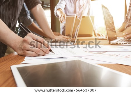 business team meeting to discuss business project document in office #664537807