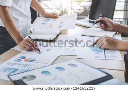 Business team meeting working with new startup project, discussion and analysis data the charts and graphs, laptop using, Business finances and accounting concept.