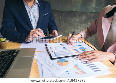 Business team meeting working with new startup project, discussion and analysis data the charts and graphs. Digital tablet calculator, laptop computer using, Business finances and accounting concept. #718437598