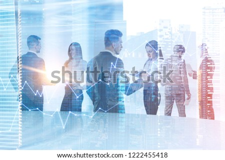 Business team members working together standing over cityscape background with forex graph foreground. Toned image double exposure #1222455418